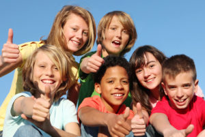bigstock-happy-kids-with-thumbs-up-16236434